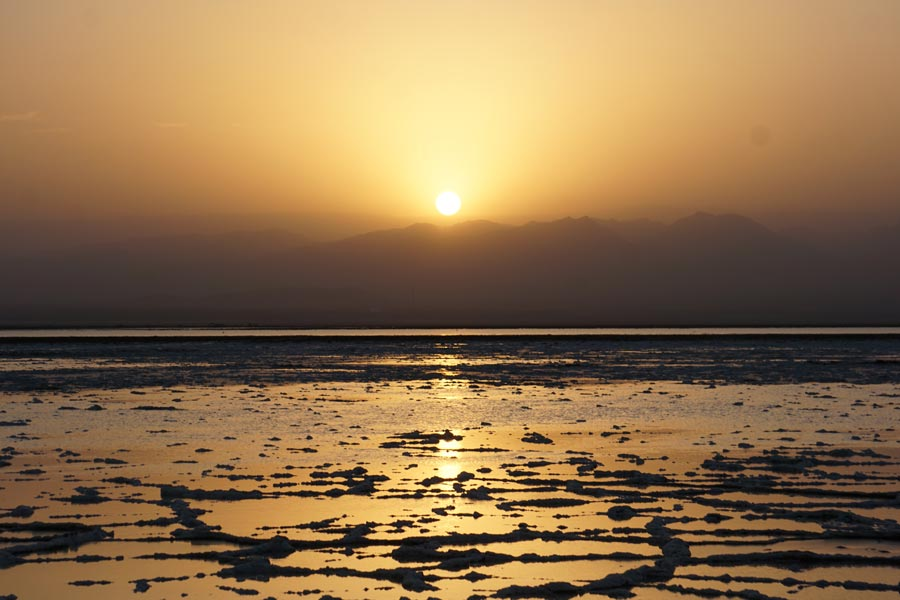 Sunset in the salty lakes during the Danakil Depression tour
