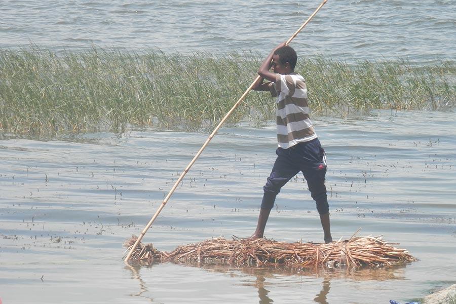 Young boy fishing in Awassa Lake