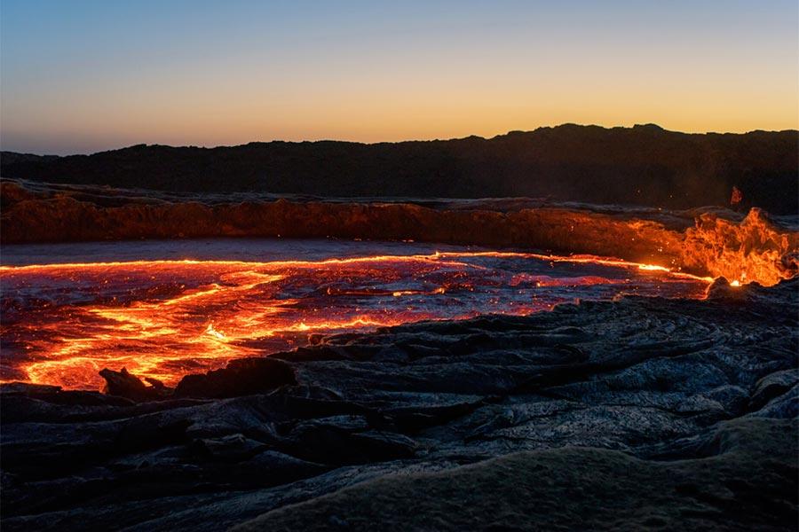 The big caldera of the active volcano of Erta Ale in the Danakil