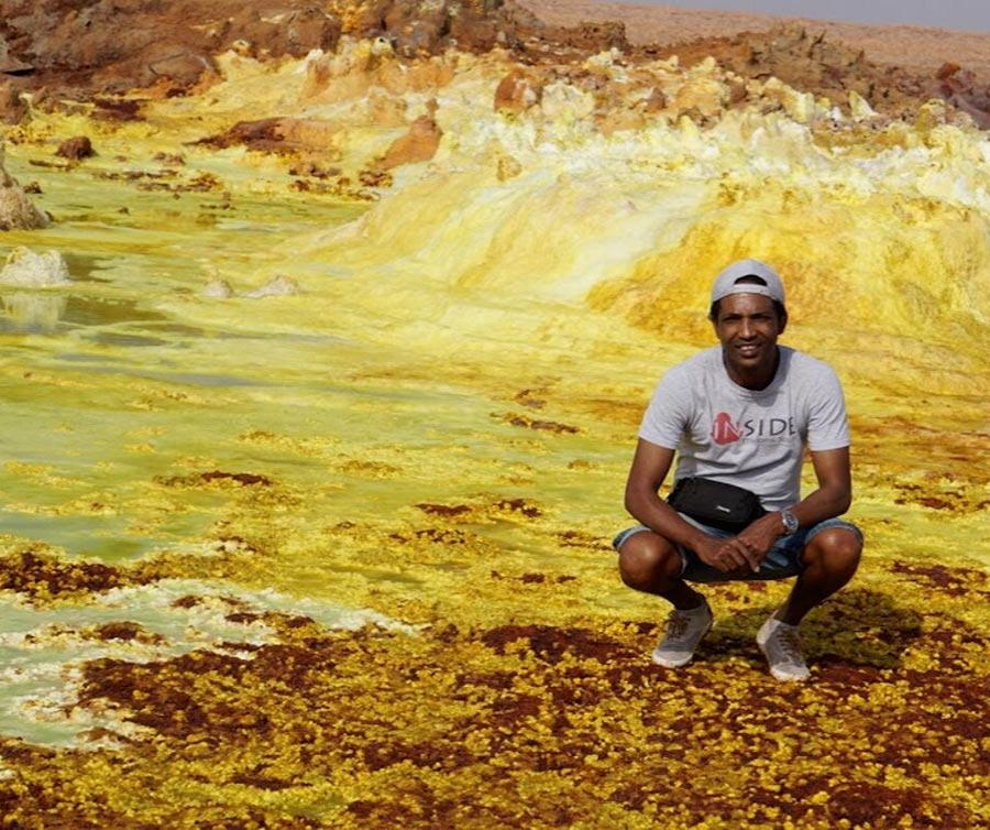 a picture of the founder of Inside Ethiopian Tours which is a Ethiopian travel companies in front of danakil