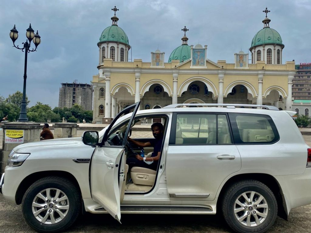 New Toyota Landcruiser infront of Bole Medanhialem Church in Addis Ababa
